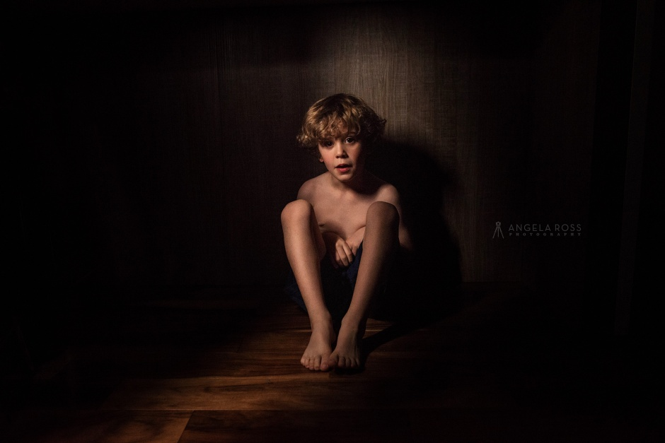 boy-island-hiding-icelight-angela-ross-photography